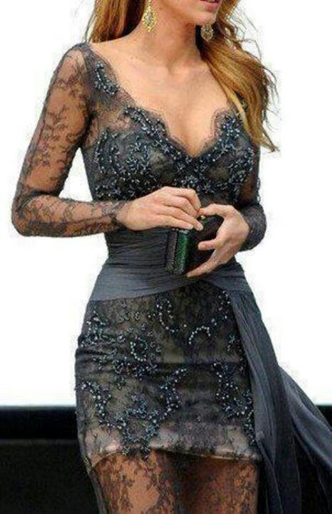 Be STEEL, my beating heart! This dress has it all_ with it's sultry steel gray color, I could've sworn the smoke alarm went off... the intricate lace, the subtle, shimmering beading, the scalloped, plunging V neckline, the sheer, delicate sleeves....