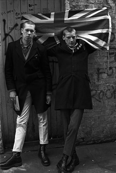 "skinheads- the skinheads grew out of ""hard mods"" and were considered to be a subculture by the late 60s. Skinheads were ""aggressively proletarian, puritanical and chauvinist...(55). Skinheads were characterized by ""cropped hair, braces, short, wide levi jeans or functional sta-prest trousers, plain or striped button-down Ben Sherman shirts and highly polished Doctor Marten boots"" (52). The skinheads drew from two incompatible sources, west indian immigrants and white working class culture."