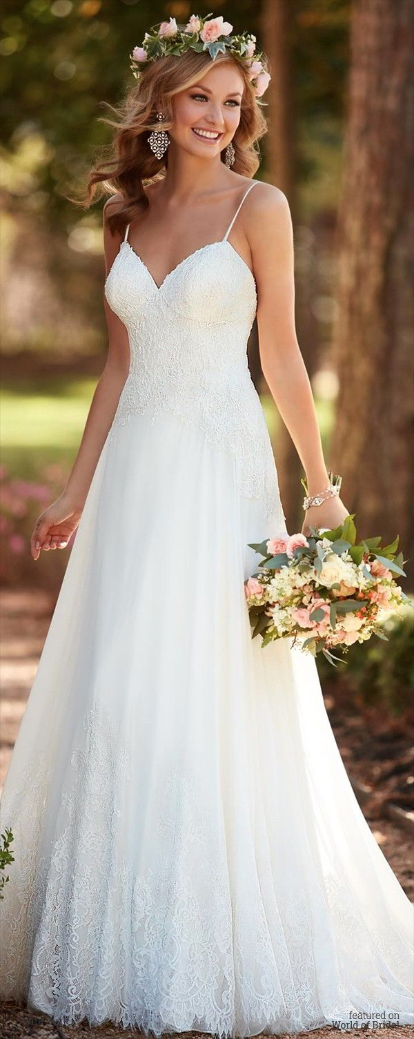 This sexy lace wedding dress from Stella York is lighter than air with chiffon and corded lace to make your walk down to aisle dreamy. Sexy spaghetti straps and a sweetheart neckline frame the face. The low-cut back zips up with ease under nine fabric-covered buttons. The train fans out with an elegant spray of scalloped lace.