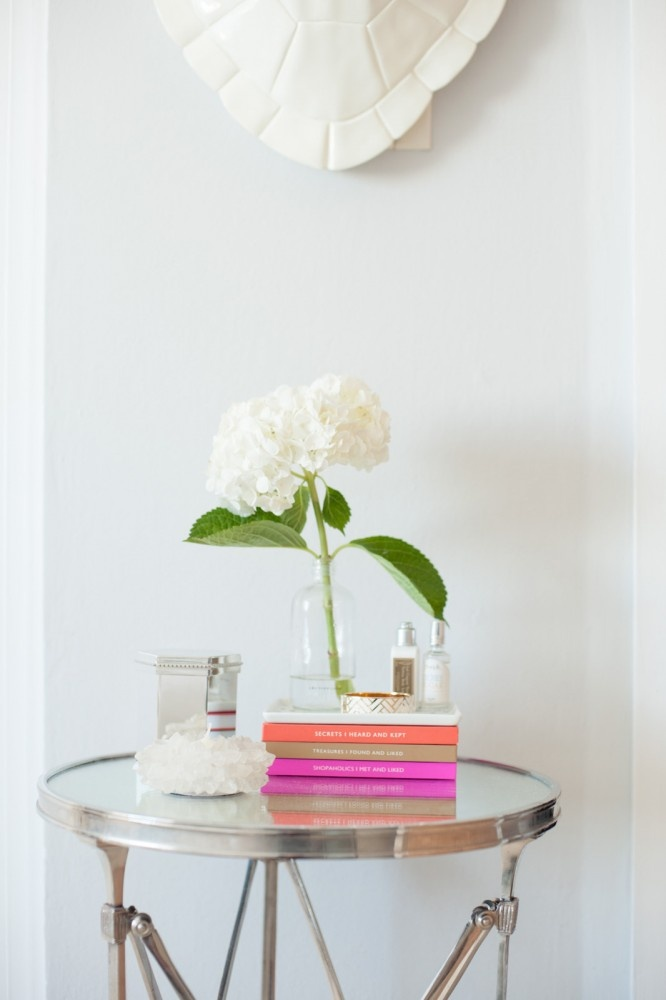 Small pile of books, decorative box and flowers