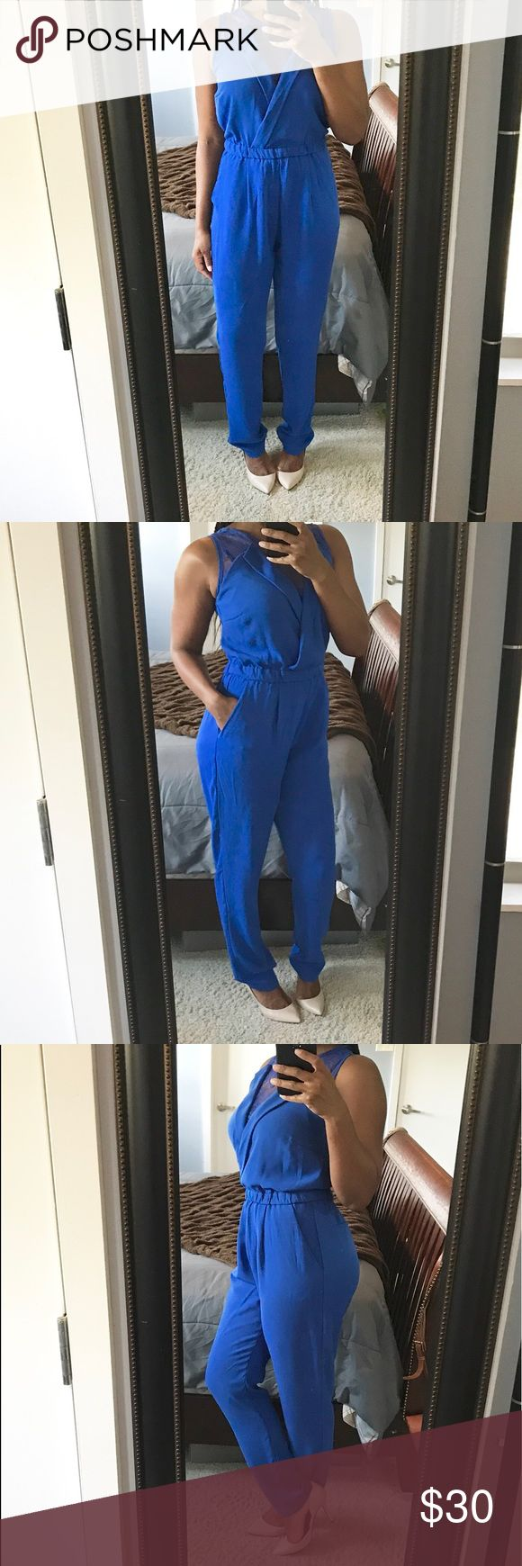 Semi Casual Jumpsuit!! Beautiful royal blue jumpsuit with a v neckline and sheer lace detailing on bodice, functioning side pockets, lace on back, elastic waist and a concealed back zip! Sociology Pants Jumpsuits & Rompers