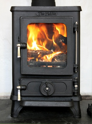 Stove studios and home on pinterest for Most efficient small wood burning stove