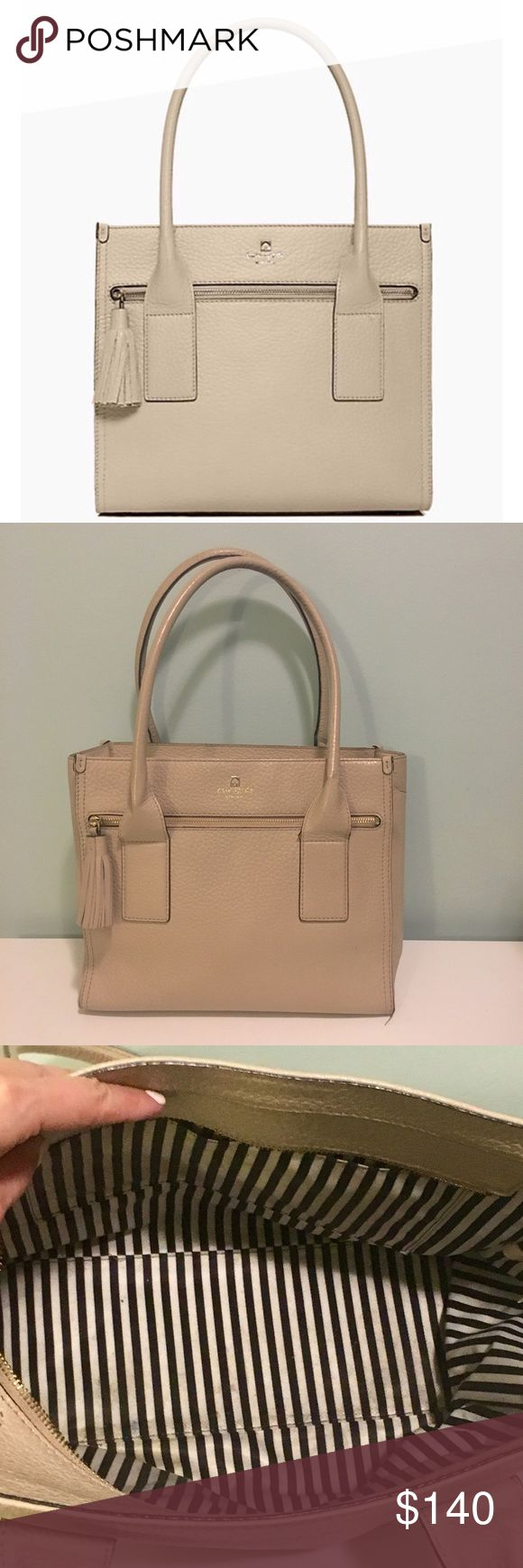 """Kate Spade Southport Avenue Cameron Leather Tote Smart in structure and iconic in style. Great bag for work! Good condition. Keywords: tan, nude, neutral, beige, purse, bag, career, shoulder bag, tassel, structure, structured. Features Tote bag in pebble embossed cowhide with matching trim gold printed kate spade new york signature 14-karat light gold plated hardware Front zip pocket with tassel zipper pull custom woven bookstripe lining with zip & slip pockets. 12''h x 12.9''w x 5.5''d 9""""…"""