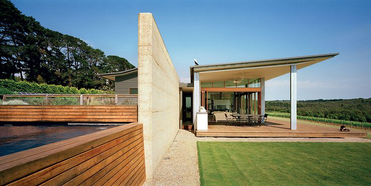 The heavy rammed earth wall defines the circulation spine through the centre of Hill House | Hill House by Mihaly Slocombe (2006) | Merricks, Victoria, Australia | photo: Emma Cross