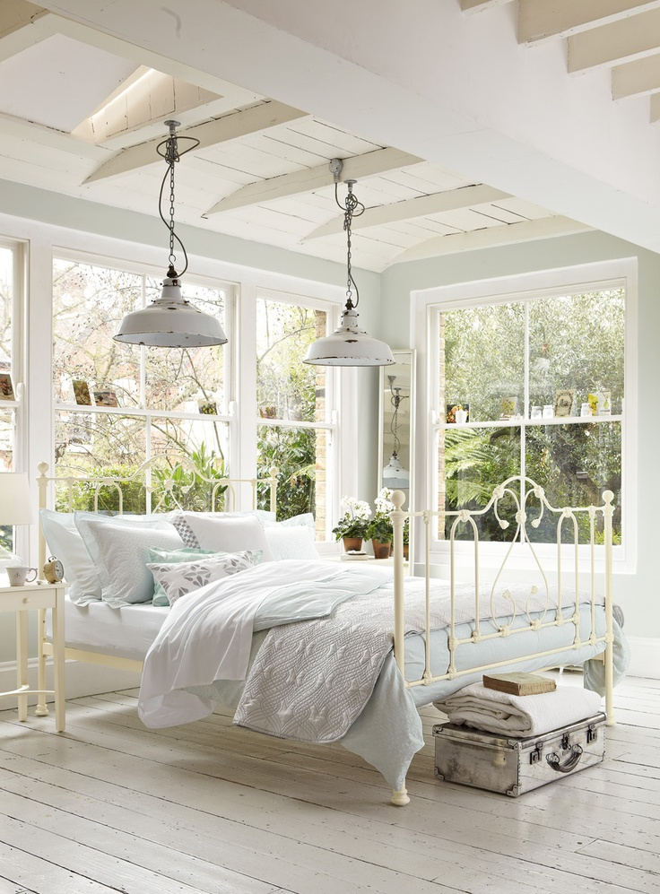 So bright and airy love the windows lights and the white painted wood floor take wonderful white decor