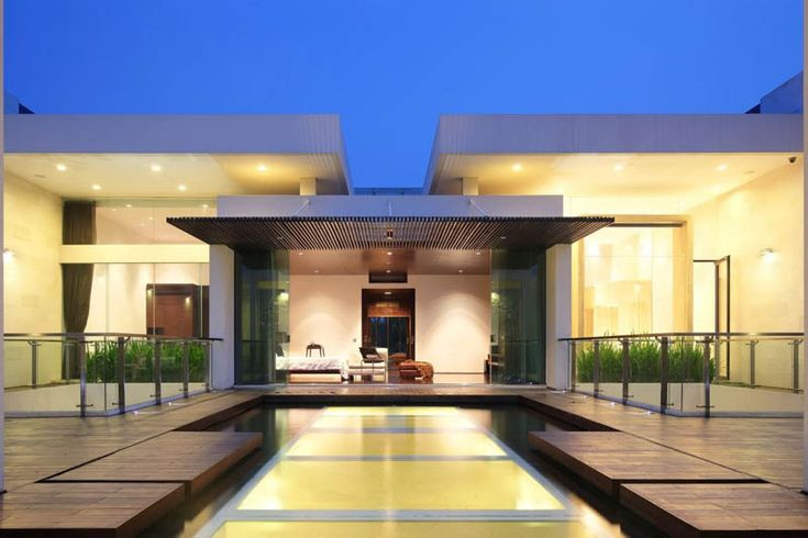 Open outdoor plan utilizing wood, water, glass and symmetry for striking effect