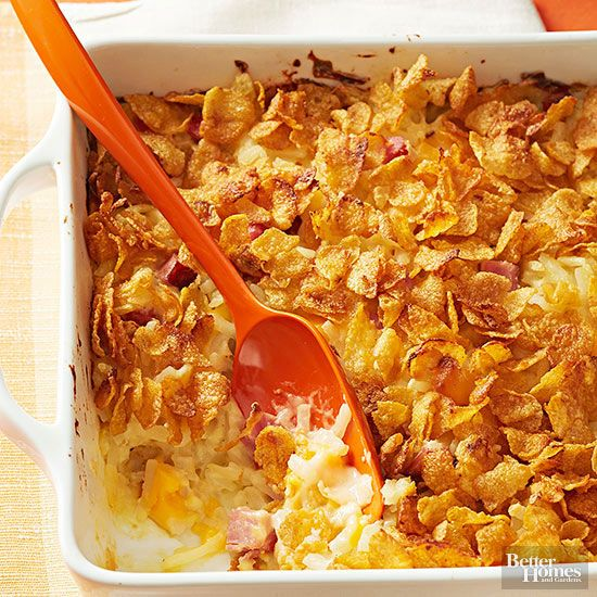 Called party potatoes in some circles, hash brown casserole is a must-have holiday recipe! Shredded potatoes, sour cream, cheese, ham, and a buttery cornflake topper combine to create a casserole recipe that will be the first thing devoured at your holiday buffet./
