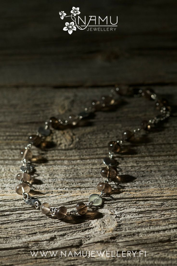 Silo One Necklace. Made of handcrafted, recycled silver and ethically sourced smokey quartz from Uhlu, Finland. The stones in Silo are tumbled to remind pebbles at a beach.