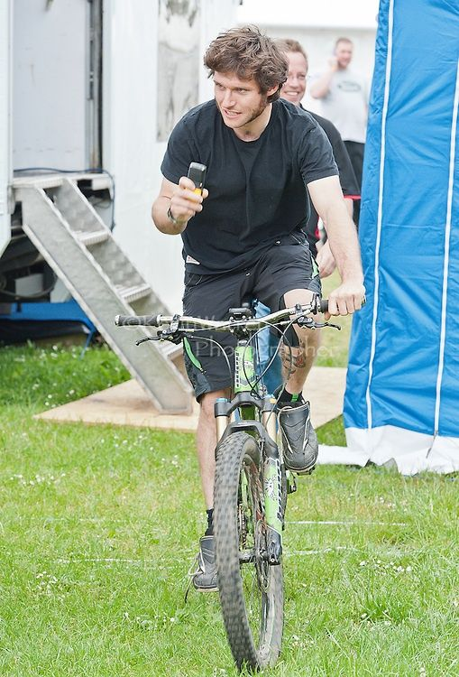 Guy Martin, motorcycle racer and avid cyclist makes his way out of the back at the Tyco Suzuki paddock trailer.