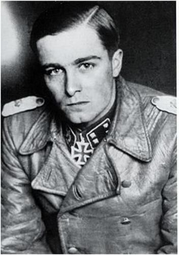 Joachim Peiper was a field officer in the Waffen-SS during World War II & personal adjutant to Reichsführer-SS Heinrich Himmler between November 1940 & August 1941. By 1945, he was an SS-Standartenführer & the Waffen-SS's youngest regimental colonel. He was convicted of war crimes committed in Belgium & accused of war crimes in Italy. He was murdered in France in July 1976, after his house was attacked with Molotov cocktails... Cute guy, shame he was a nazi.