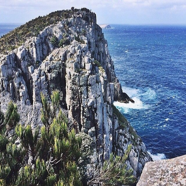 From Cape Hauy looking over the sea cliffs on The Lanterns out to the Tasman Sea. Cape Hauy is one of Tasmania's 60 Great Short Walks; about a four-hour return circuit through the Tasman National Park.  #discovertasmania #capehauy #walking #tasmannationalpark #tasmania Image Credit: Tara Sydney