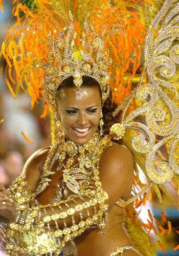 Carnival season has started in Brazil and that means scantily clad women wearing giant feathers. We don't know if ladies in carnival costumes is a fetish, but if not it should be. It takes most of the year to build the outfits these dancers wear.