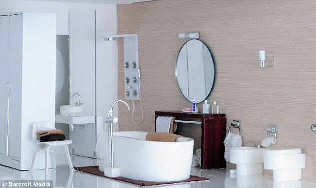 The chic bathroom has a modern shower, stylish bidet and large circular mirror that Elaine made by hand.
