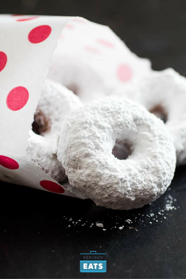 Like the ones made by Hostess, my Donettes are fluffy bites of yellow cake swaddled in a messy coat of powdered sugar, and small enough to eat by the handful. They're a little tangy, like the original, but from thick Greek yogurt rather than some mystery additive, with a vibrant color and custardy richness from a couple of egg yolks.