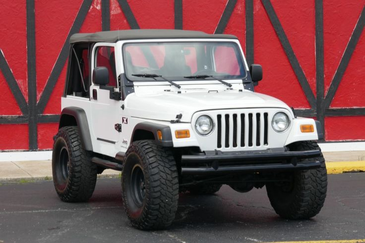 2003 Jeep Wrangler - Suspension Upgrades - 4x4 - Very Clean -   ***NEW LOWERED PRICE ASKING $14,500***  North Shore Classics  149 North Seymour Avenue   Mundelein, IL 60060  (847) 393-7887  www.nsclassics.com  WE FINANCE/ DELIVER AND SHIP WORLD WIDE