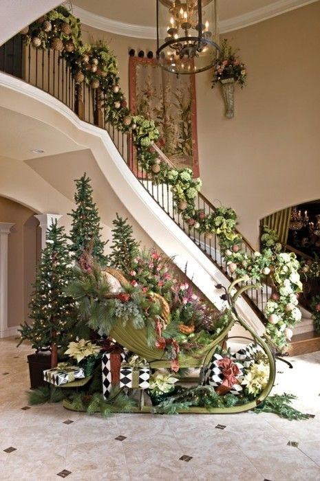 Stunning Christmas decorations... curved staircase. garland. trees. ornaments. lights.