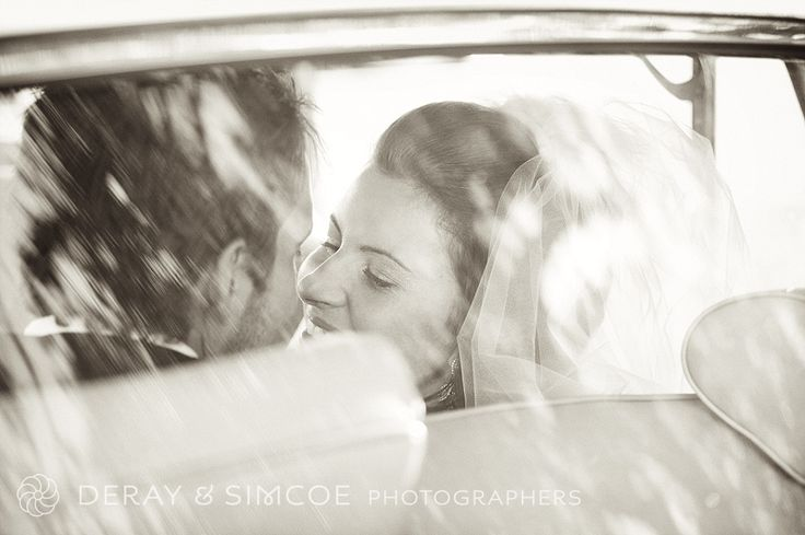 Timeless and classic. Bride and Groom photo looking through the wedding car window