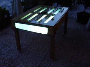 http://www.zummolo.com/index.php?do=/marketplace/20/pallet-table-with-back-lighting-provided-by-solar-panel/