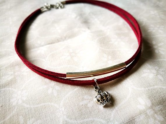 Double Tube Faux Suede Choker and Crown Charm (Silver Plated Charm)    A handmade fashion forward choker  Length: 36cm + an additional cm chain to allow for adjustments  Please measure your neck BEFORE paying for a purchase     You can find me on:  https://www.facebook.com/UniquelyKraftedSA/  https://www.instagram.com/uniquelykrafted/  https://za.pinterest.com/uniquelykrafted/