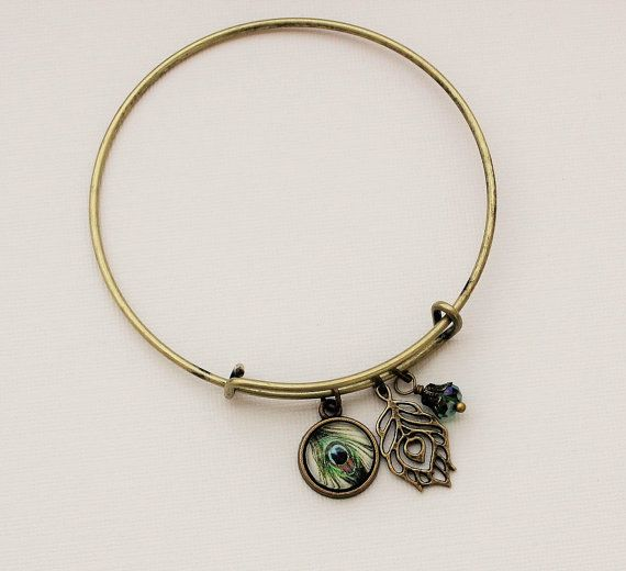 Hey, I found this really awesome Etsy listing at https://www.etsy.com/listing/239180563/peacock-bangle-charm-bracelet-in-antique
