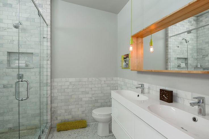 Modern ranch marble subway tiles and ikea cabinets on for Modern ranch bathroom