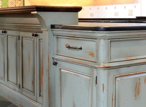 Light blue distressed cabinets That would be cool for an island, not