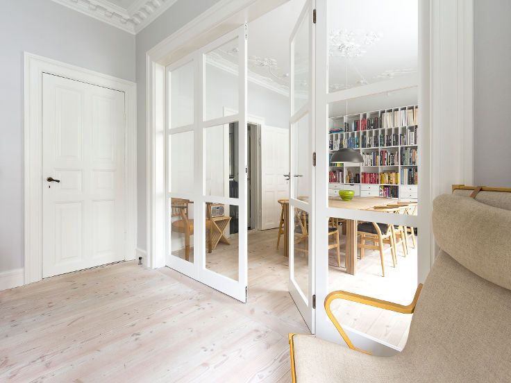 Two small living rooms with a folding glass door seperating them