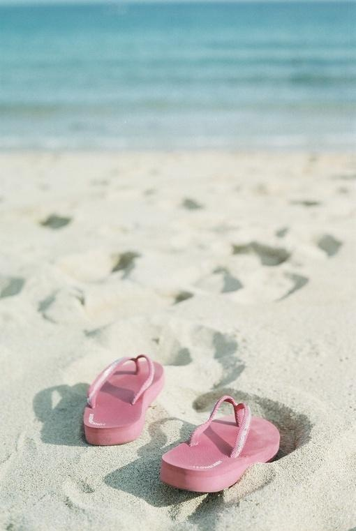 Take out the flip flops. Us all lined up at the waters edge. With our foot prints in focus. LOVE LOVE LOVE!!!