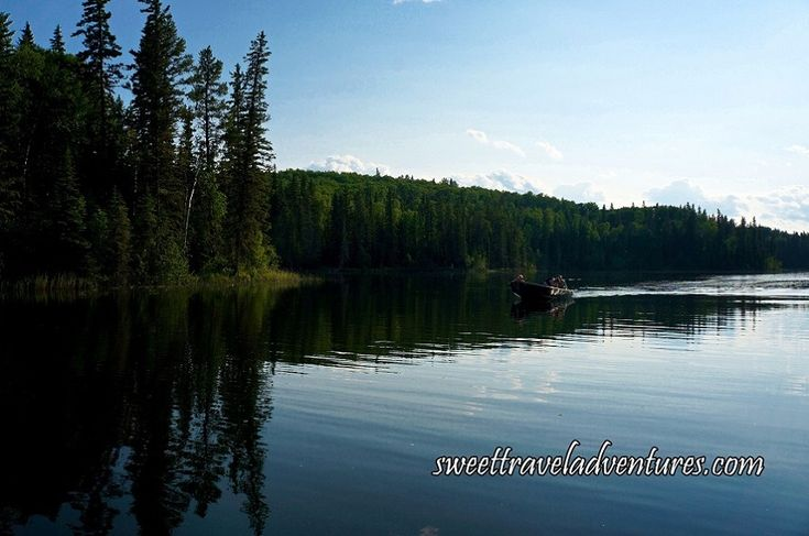 Fishing Boat on First of the Hanging Heart Lakes in Prince Albert National Park, Saskatchewan, Canada