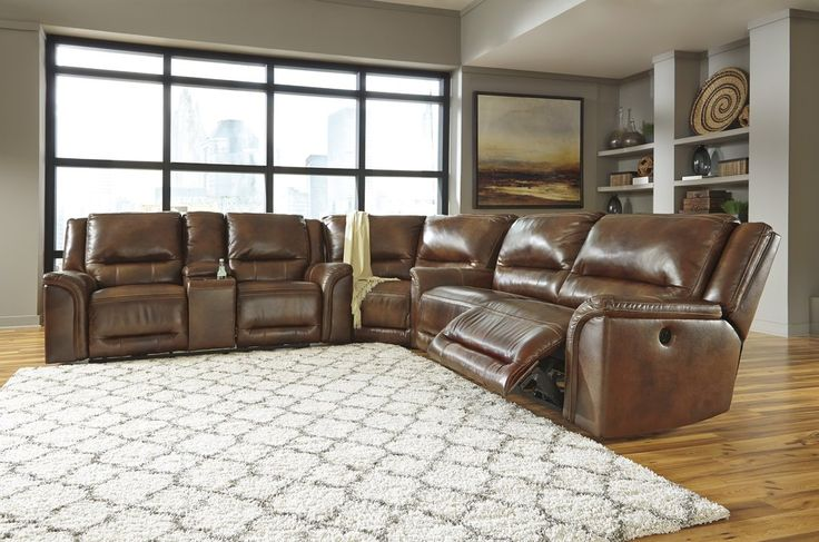 Jayron Contemporary Leather Harness Color Reclining Power Sectional Sofa. Supple leather will surround you in comfort and equestrian style in the Jayron power reclining sofa. #Sofa #Loveseat #Sectional #Brown #Chocolate #Leather #Recling #Jayron #Living Room #Ashley – Furnituremaxx