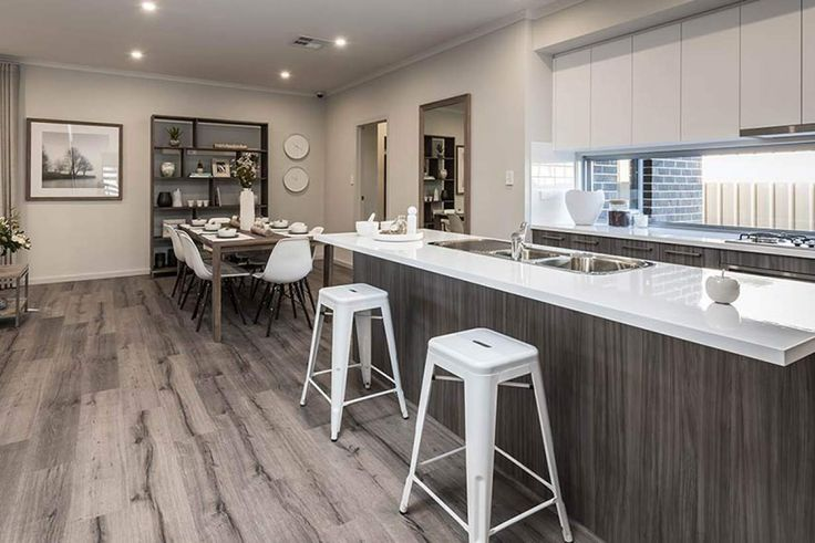 This gorgeous breakfast bar is the perfect place to start the day. #weeksbuildinggroup #newhome #homedesign