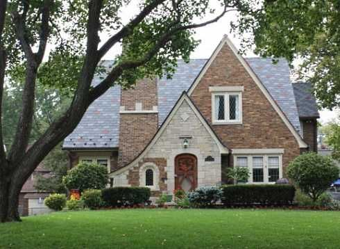 The 1920s Tudor Revival cottage pictured below is located in  Indianapolis, Indiana, USA.  It features a picturesque combination of stone and brick on its exterior.