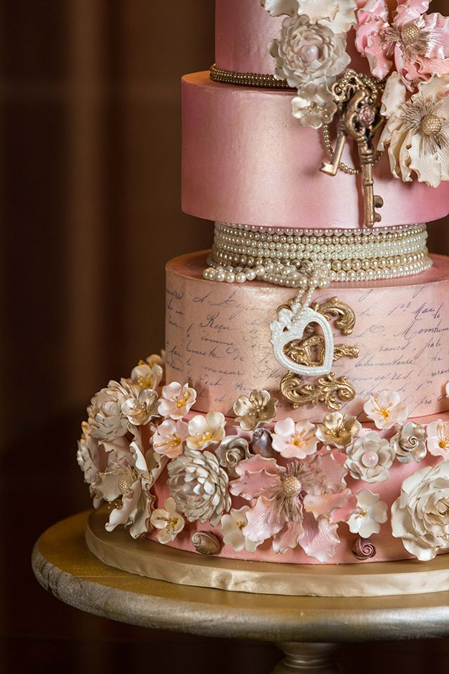 Look at all the intricate details in this wedding cake. Find out more details when you click the photo!