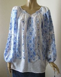 Stunning hand made Romanian peasant blouse , hand embroidered with medium blue cotton thread .