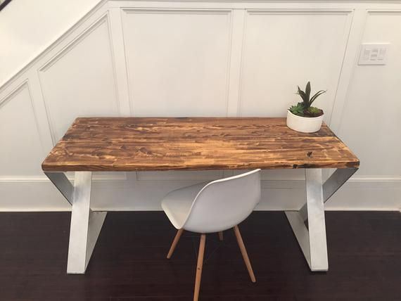Save $200! (Marked down from $699) This hand crafted solid wood table is mounted on modern era aluminum legs that are artisan welded to a 'Z' shape. All compone