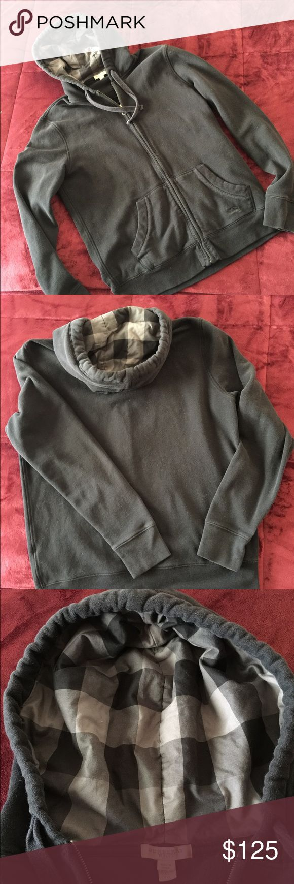 "Burberry Brit Men's Black Hooded Sweatshirt 176. This is the sweatshirt you have been wanting! It is now within your reach! It is in excellent preowned condition with no tears or flaws. It has been washed several times and will look good for years! The quality is obvious. It has the icon on front pocket and is made of soft Cotton and Polyester. The hood is lined and puffy and is gray and black wide plaid. It is cool! Impress your friends!  The measurements are slim 22"" across chest pit to…"