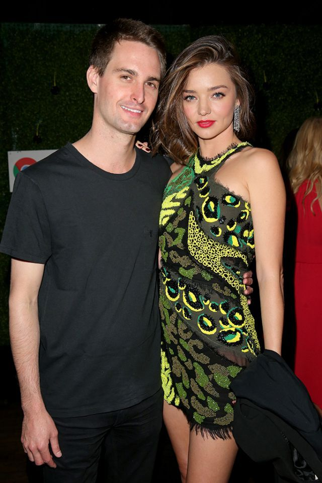 Miranda Kerr and entrepreneur Evan Spiegel made their relationship red-carpet official just in time for Valentine's Day and kept the romance showin' at the Republic Records party. (Imeh Akpanudosen/Getty Images)