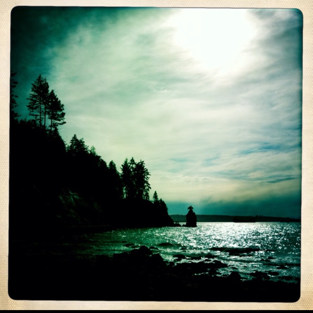 Siwash Rock, separated from Stanley Park by the seawall.