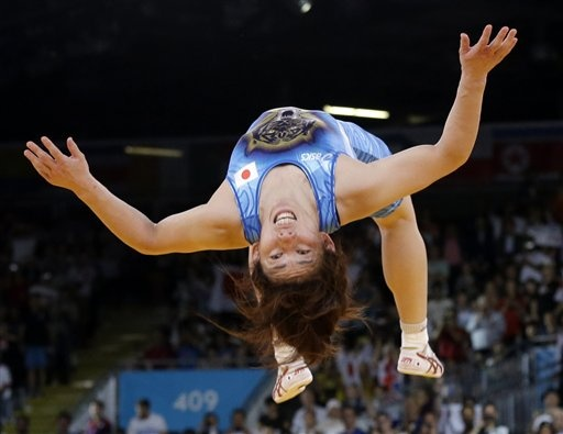 Saori Yoshida of Japan celebrates by doing a backflip after she beat Tonya Lynn Verbeek of Canada for the gold medal during their 55-kg women's freestyle wrestling competition at the 2012 Summer Olympics, Thursday, Aug. 9, 2012, in London. (AP Photo/Paul Sancya)