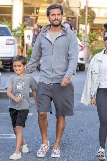 Scott Disick wearing Vans Digi Aloha Slip-Ons and John Elliott Flash Dualzip Hoodie in Grey