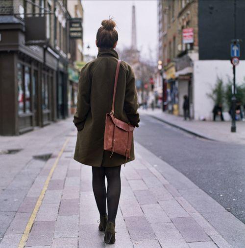 dark olive green coat and leather shoulder bag