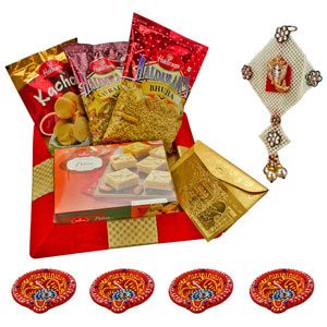 Spread the sweetness of your love with this special hamper of sweets , namkeens and Ganesha's blessings.  Costs Rs 1429/-  http://www.tajonline.com/diwali-gifts/product/d4412/haldirams-sweet-spicy-diwali-present/?aff=pinterest2013/