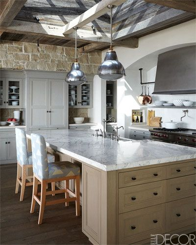 Custom made kitchen cabinetry and island with antique Belgian light fixtures.
