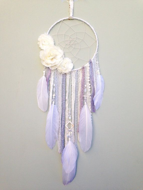 White flower dream catcher by Inspired Soul Shop on Etsy. Dreamcatcher decor is beautiful for any bedroom, nursery or living space. Dreamcatcher Details// 7inch diameter The dream catcher colors are white, ivory and gray and mauve accents. White and ivory colored flowers. White feathers. Made with beads, lace, crochet, suede and feathers.  Ready for shipping. Check out my shop for more dreamcatchers, boho decor, feather wall hangings and more