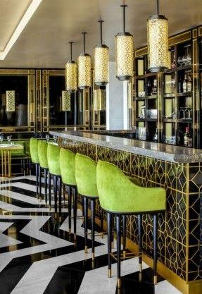 song qi, monaco   green bar stools, geometric floor pattern, black and white