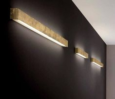 wide DIY-friendly box sconces for indirect lighting (would work better against a light-colored wall)