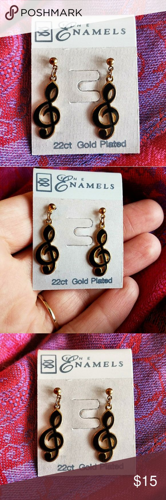 Vintage treble clef earrings gold drop music note This pretty pair of Treble Clef dangle earrings is still on the original card! They are made of 22kt gold plated metal with black enamel. Rubber stopper backs, pierced posts. They are in like new condition, never worn. By Fine Enamels. From a smoke free home:)  BeeA8858note9k6g Vintage Jewelry Earrings