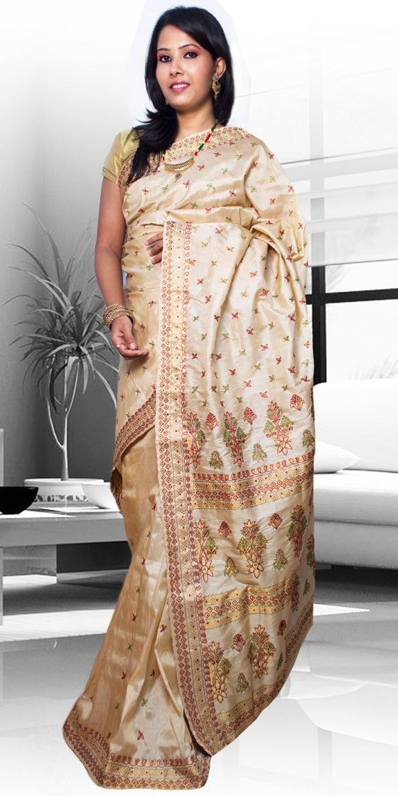 Beautiful Golden colour Muga Tassar Pat Assam silk saree  with artistic Guna and Suta work giving an ethnic look to the collecion. This gorgeous Pat Tassar silk Saree is perfect for any festive occasion. The Saree comes with matching blouse piece, the blouse shown in the image is just for display purpose.Slight colour variation may be there in display & actual.