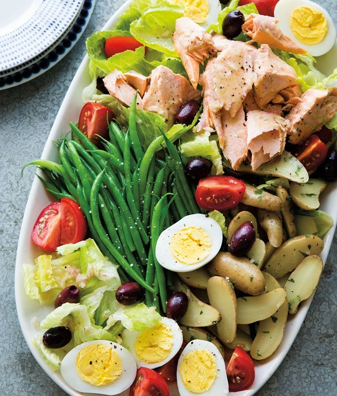Poached Salmon Niçoise | Our twist on the classic salad of Nice, France has poached salmon—along with boiled potatoes, hard-cooked eggs and lettuce.