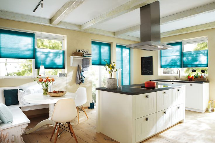 Sunshine, blue blinds and glossy white kitchen